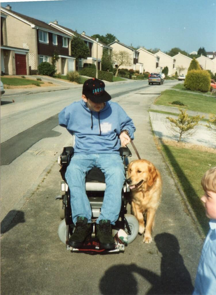 Steven Webb with his dogs for the disabled dog Ben